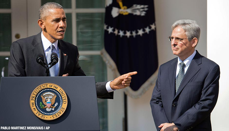 Federal appeals court judge Merrick Garland, stands with President Barack Obama as he is introduced as Obama's nominee for the Supreme Court during an announcement in the Rose Garden of the White House, in Washington, Wednesday, March 16, 2016.