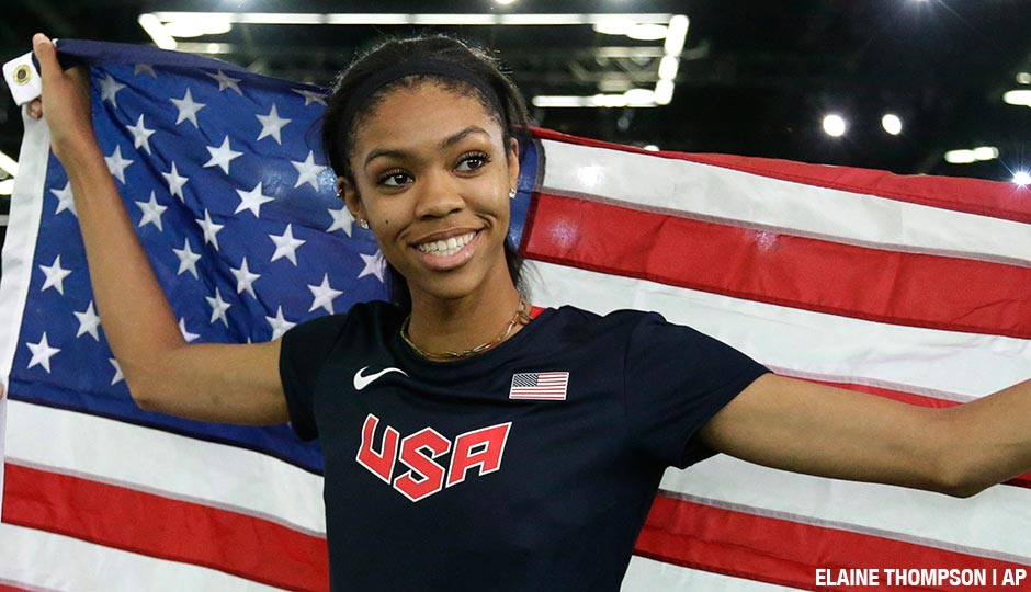 Vashti Cunningham holds the U.S. flag after winning the women's high jump final during the World Indoor Athletics Championships, Sunday, March 20, 2016, in Portland, Ore. Cunningham won the event.