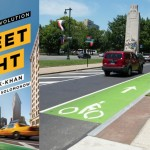 The evolution of Philly's bike lane network and the launch of the Indego bike-share system owe a debt to Street Fight author and former NYC Transportation Commissioner Janette Sadik-Khan. Modified photo of Ben Franklin Parkway bike lane | Flickr user karmacamilleon, used under CC-BY-NC-ND-2.0