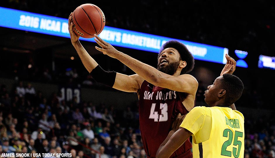 St. Joseph's Hawks forward DeAndre Bembry moves to the basket against Oregon Ducks forward Chris Boucher during the second half of their second-round matchup in the 2016 NCAA Tournament at Spokane Veterans Memorial Arena.