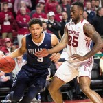 Villanova Wildcats guard Josh Hart (3) dribbles past Temple Owls guard Quenton DeCosey (25) during the first half at Liacouras Center, February 17, 2016.