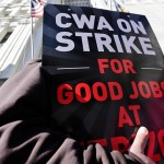 Striking Verizon workers picket outside a Verizon office on Wednesday, April 13, 2016, in Albany, N.Y.