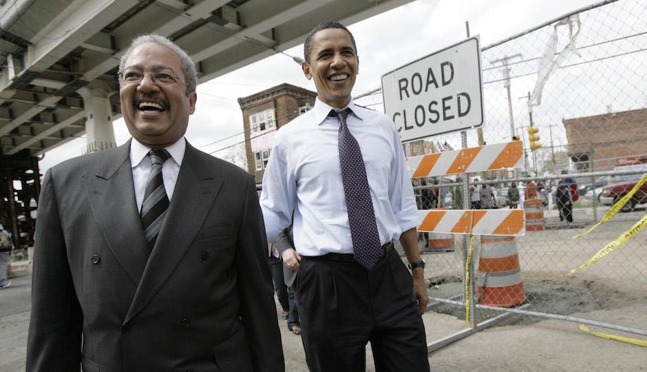 Democratic presidential hopeful, Sen. Barack Obama, D-Ill., center, walks with Rep. Chaka Fattah, D-Pa., left, in Philadelphia, Tuesday, April 22, 2008. (AP Photo/Jae C. Hong)