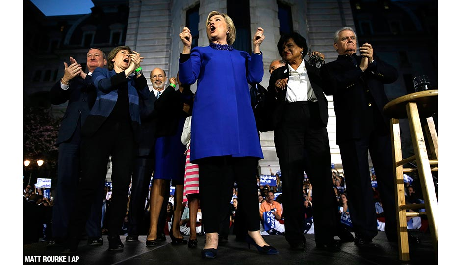 Democratic presidential candidate Hillary Clinton stands with Pennsylvania elected officials during a campaign stop, Monday, April 25, at City Hall.