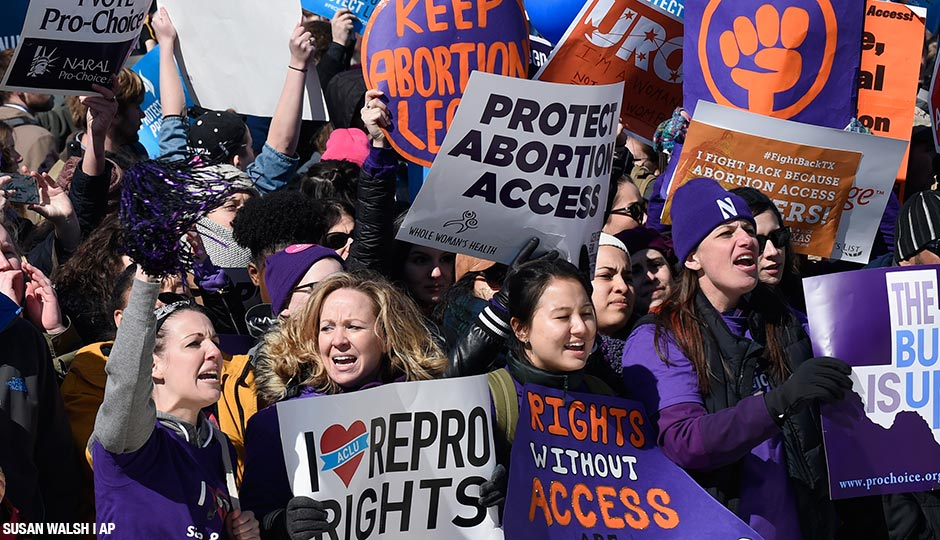 Pro-abortion rights protesters rally outside the Supreme Court in Washington, Wednesday, March 2, 2016.