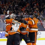 The Flyers celebrate after winning against the Washington Capitals Wednesday, 2-1.