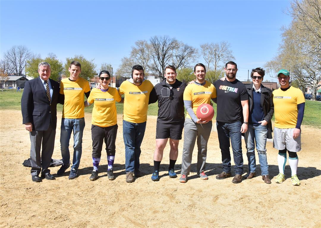 Mayor Jim Kenney, State Rep. Brian Sims, and Nellie Fitzpatrick photographed with members of Stonewall Sport's Kickball Team. Photography by Hugh E. Dillon.