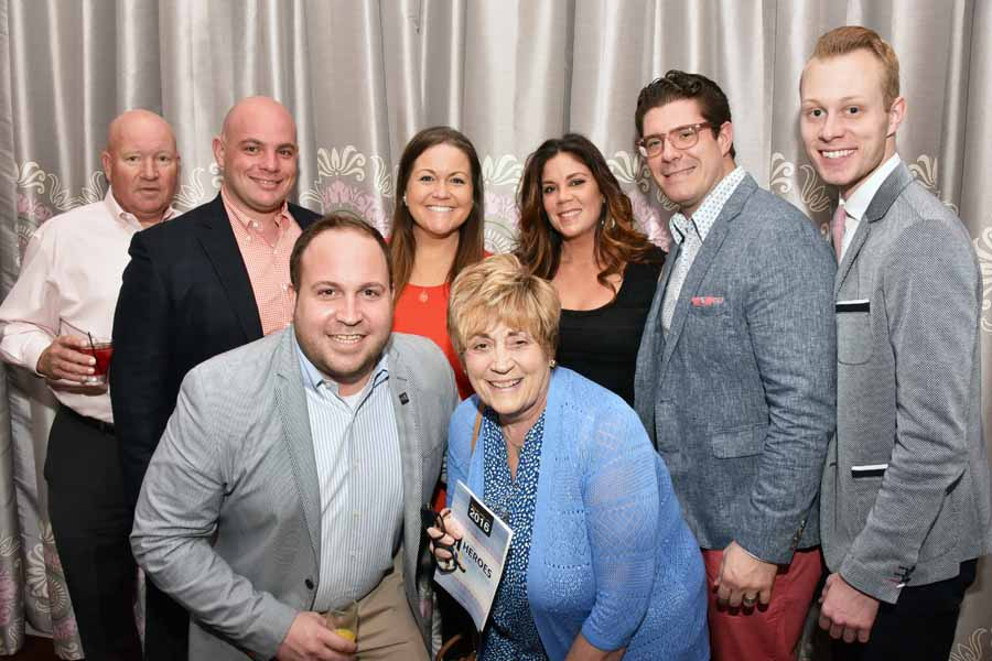 The Team from Table 95 Hospitality which consists of Field House, Tap House and Penn 6, was honored with the Business HERO Award for their longstanding support of many organizations in the LGTBQ community. Tim Adams  (front left) and Puri Garzone (2nd from right at top) accepted the honor on behalf of the group. Photography by Hugh E. Dillon.
