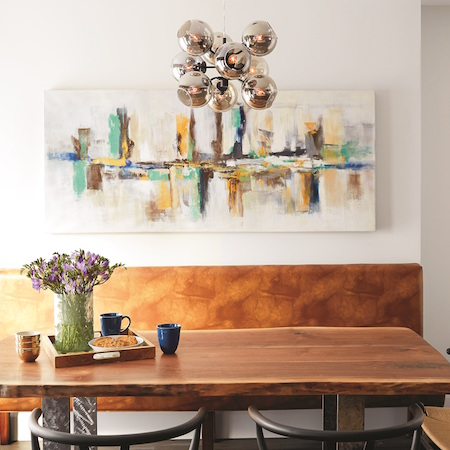 The brothers used the original hardwood studs from a home they renovated to create a dining table. © 2016 SB Publications LLC; interior photography © 2016 David Tsay