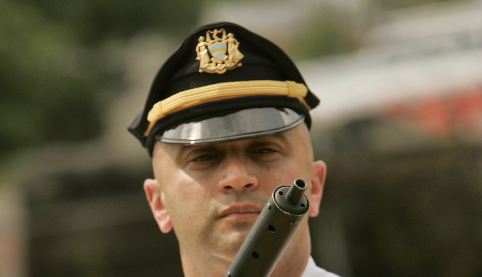Philadelphia Philadelphia police Lt. Vince Testa holds a confiscated submachine gun at the force's north Philadelphia firing range Wednesday, July 25, 2007. The weapon, which police described as being assembled from a kit in the style of a World War II British Sten gun, was taken along with another weapon and narcotics as two men were arrested in south Philadelphia on Tuesday. (AP Photo/George Widman)