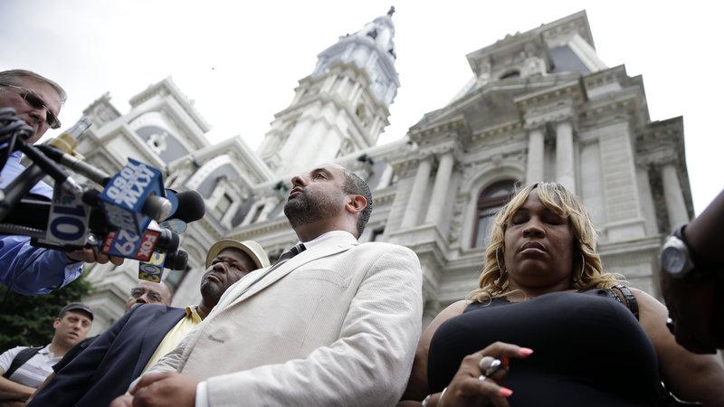 Attorney Brian Mildenberg (center), Tanya Brown-Dickerson (right), mother of Brandon Tate-Brown (Matt Rourke/AP)
