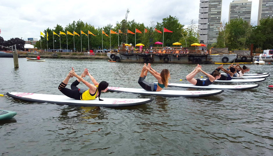 SUP Yoga at Spruce Street Harbor Park | Photo via Facebook