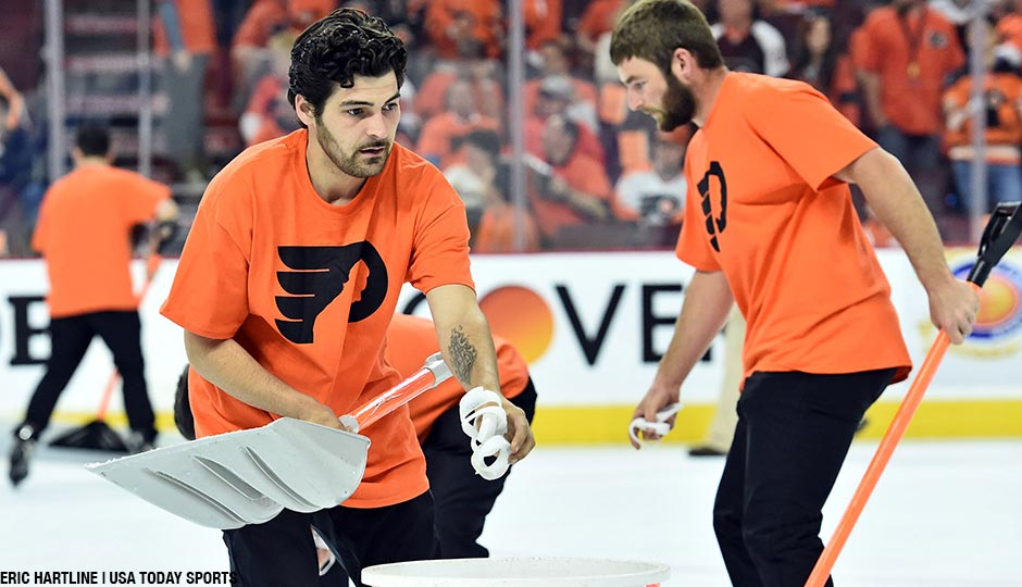 Members of the Philadelphia Flyers Ice Crew pick up wristbands that were thrown onto the ice during the third period against the Washington Capitals in game three of the first round of the 2016 Stanley Cup Playoffs at Wells Fargo Center.