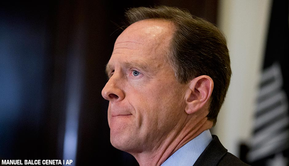 Sen. Patrick Toomey, speaks to reporters outside his office in Washington on April 12, 2016.