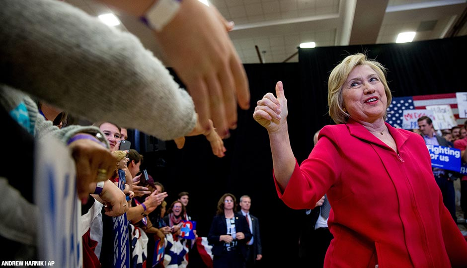 Democratic presidential candidate Hillary Clinton, center, arrives to speak at a get out the vote event at Transylvania University in Lexington, Ky., Monday, May 16, 2016.