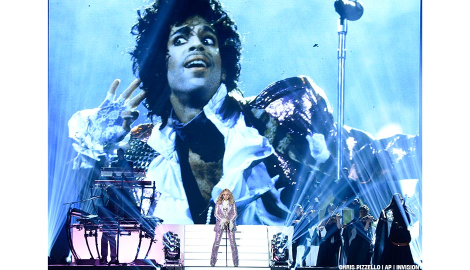 Madonna performs a tribute to Prince, pictured onscreen, at the Billboard Music Awards at the T-Mobile Arena on Sunday, May 22, 2016, in Las Vegas.