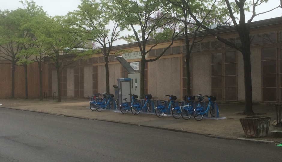 Indego bike stations like this one in front of the Cecil B. Moore branch of the Free Library in Sharswood form a link in an emerging alternative transportation network that many house-hunters find increasingly appealing. | Photo: Sandy Smith