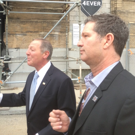 Left to right: William Procida and Eric Blumenfeld explain the Divine Lorraine restoration project to the tour group outside the hotel.