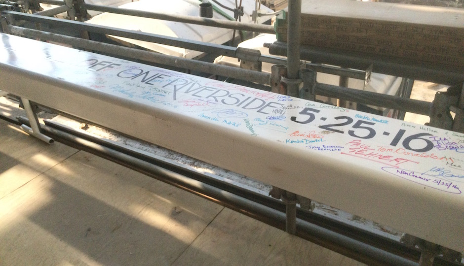 The beam guests signed at the ceremony may be purely symbolic, as One Riverside's frame is largely complete, but it symbolizes years of planning and construction as well as the last piece in the transformation of the Schuylkill riverbank from dump to jewel. | Photos: Sandy Smith