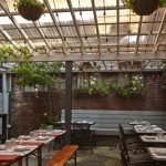 Outdoor garden at Little Nonna's | Photo by Jason Varney