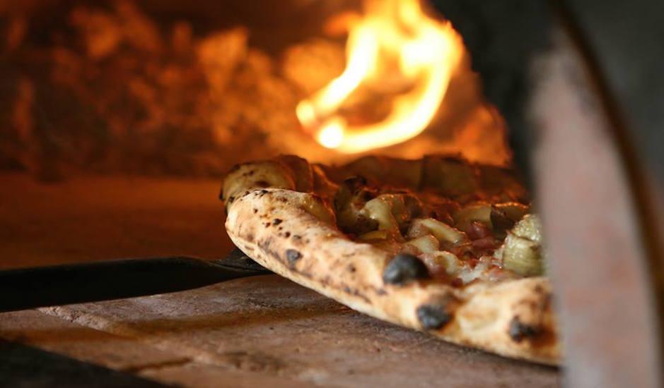 Pizza oven at Capofitto | Photo via Facebook