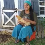 Malaika Hart hugs a hen. (Photo courtesy Malaika Hart)