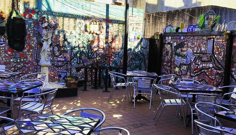 Secret Isaiah Zagar garden behind Gennaro's | Photo via Gennaro's