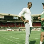 Randall Cunningham, quarterback for the Philadelphia Eagles talks with head coach Buddy Ryan during a light training session, Aug. 5, 1989, at London's Wembley Stadium where they will take on the Cleveland Browns for the 1989 American Bowl. (AP Photo/Gillian Allen)