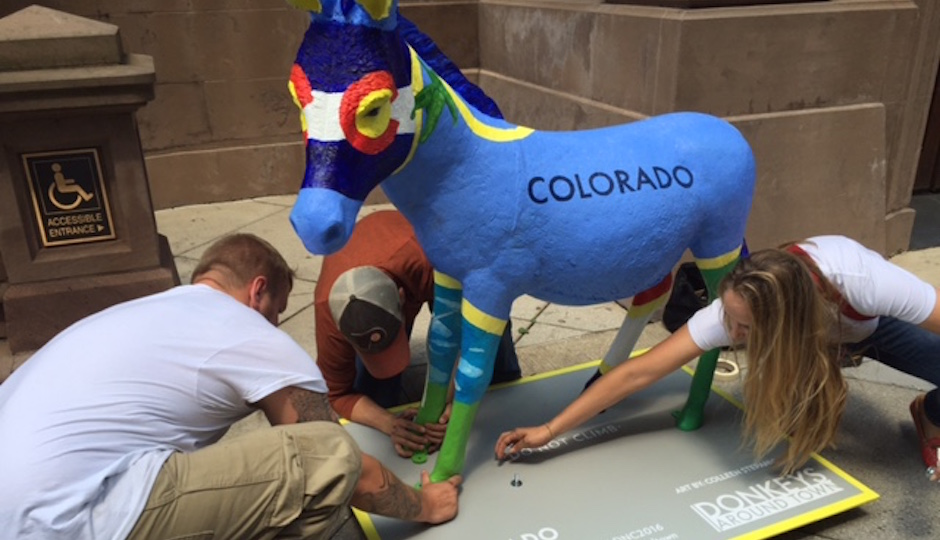 Workers unload a painted fiberglass donkey at the Union League on Broad Street