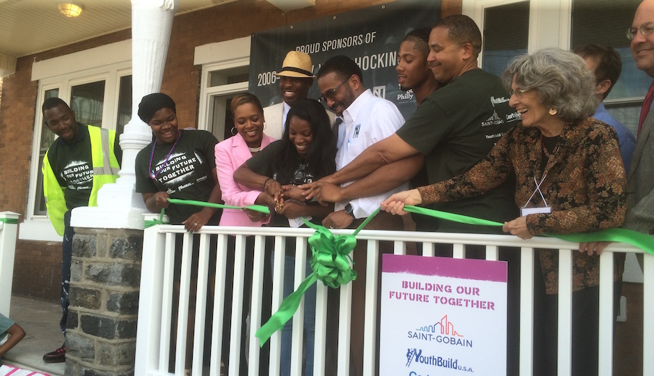 YouthBuild students (in dark green T-shirts) join (left to right) City Councilwoman Cindy Bass, City Councilman Derek Green, Nicetown Community Development Corporation Executive Director Majeedah Rashid, YouthBuild USA Founder and President [tk] and City Councilman Alan Domb in cutting the first of two ceremonial ribbons at 2006-08 Wingohocking Street, one for each house. | Photos: Sandy Smith