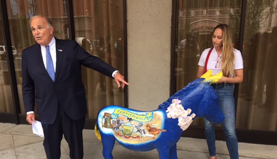 Former Governor Ed Rendell looks at the donkey painted for the Pennsylvania delegation.