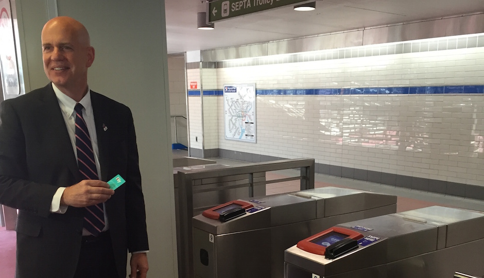 Jeff Knueppel, SEPTA general manager, uses a SEPTA Key for the first time at City Hall.
