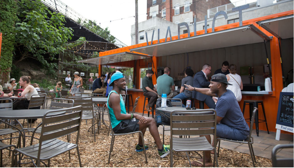 Patrons gather at the 2016 PHS pop-up garden at 10th and Hamilton Streets in Philadelphia's Callowhill District. PHS built the pop-up garden to bring awareness to the planned Rail Park. (Lindsay Lazarski/WHYY)
