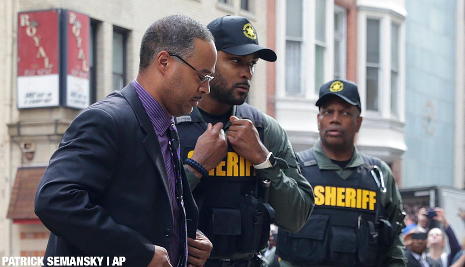 Officer Caesar Goodson, left, one of six Baltimore city police officers charged in connection to the death of Freddie Gray, arrives at a courthouse before receiving a verdict in his trial in Baltimore, Thursday, June 23, 2016.