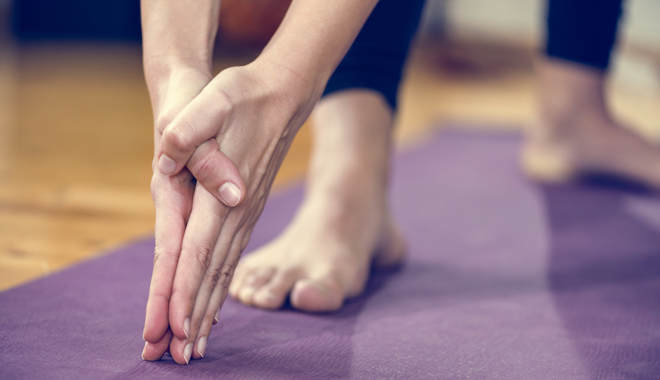 Yoga detail, hands in focus.