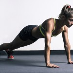 Woman doing push-ups in gym
