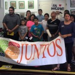 People assemble for a press conference at Juntos in response to today's Supreme Court ruling on immigration