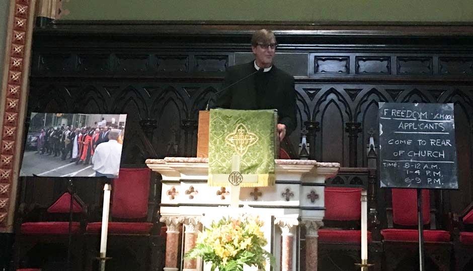 Rev. Robin Hynicka announces the DNC Freedom School at the Arch Street United Methodist Church.