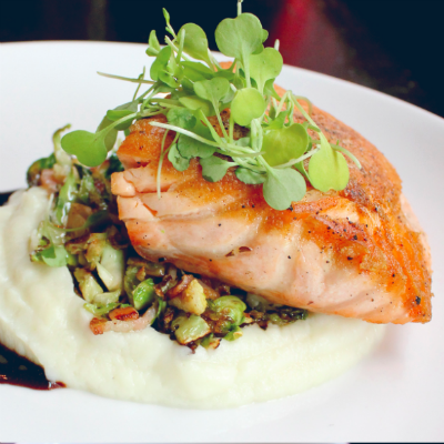Pan Seared Salmon with cauliflower puree, bacon, brussels sprouts, and port wine gastrique