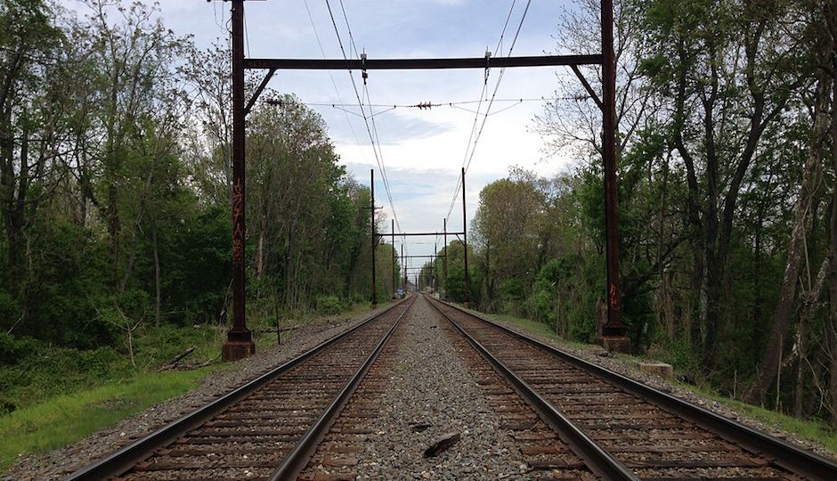 Overhead wires and steel rails expand as they get hotter. So when the temperatures get too hot, SEPTA orders its Regional Rail trains to go slow. | Photo of West Trenton Line by Famartin via Wikimedia Commons, licensed under CC-BY-SA-3.0