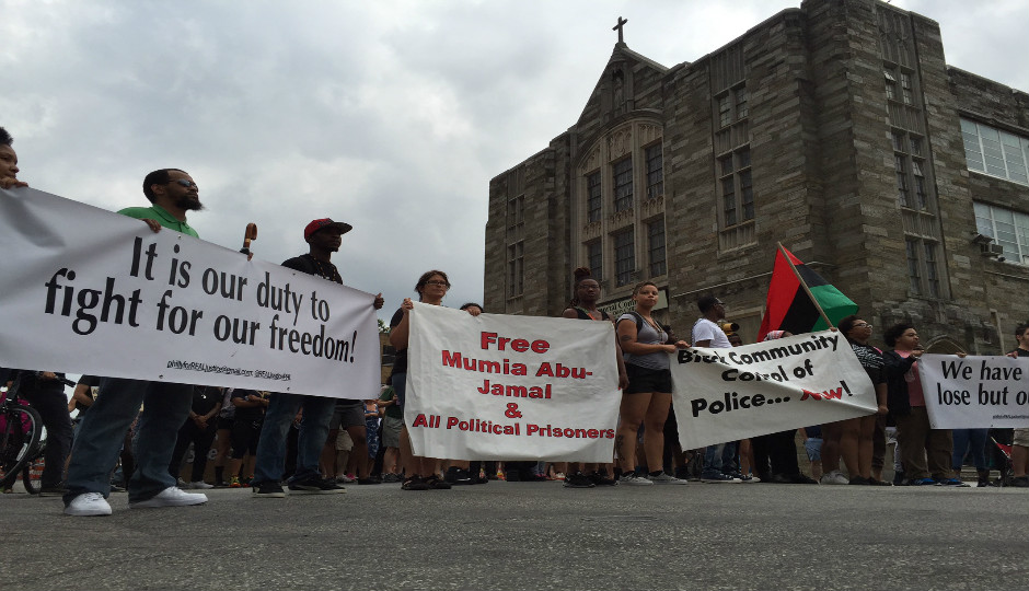 Demonstrators march through North Philadelphia to protest police shootings.