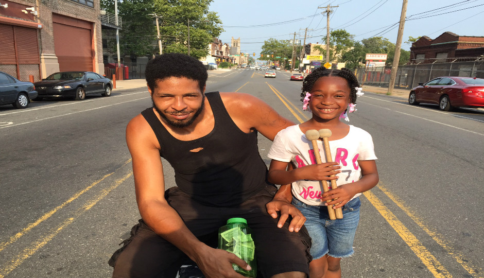 Adrian Gilliam and his daughter, Summer, try to raise money for a youth program on Lehigh Avenue.