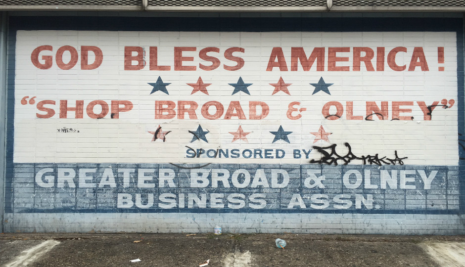 A faded sign near Broad & Olney, 12 miles from the DNC at the Wells Fargo Center.