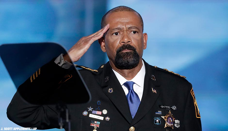 David Clarke, Sheriff of Milwaukee County, Wis., salutes after speaking during the opening day of the Republican National Convention in Cleveland.