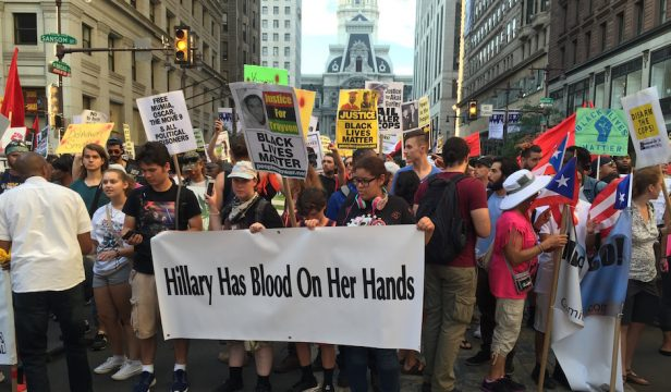 Protestors march protesting police brutality and Hillary Clinton after a rally at City Hall.