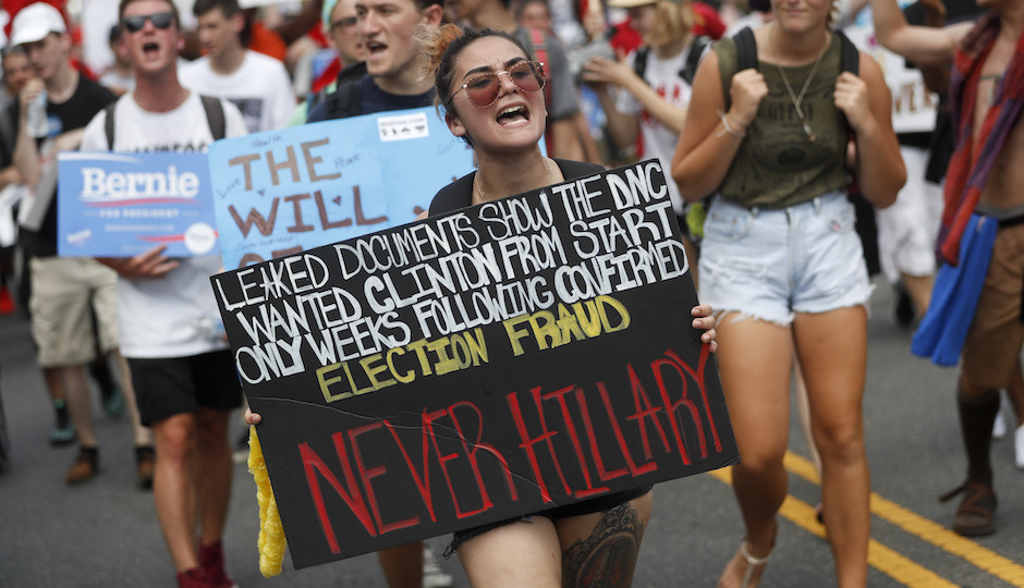 Supporters of Sen. Bernie Sanders, I-Vt., march during a protest in downtown Philadelphia, Monday, July 25, 2016, on the first day of the Democratic National Convention. On Sunday, Debbie Wasserman Schultz announced she would step down as DNC chairwoman at the end of the party's convention, after emails presumably stolen from the DNC by hackers were posted to the website Wikileaks. (AP Photo/John Minchillo)
