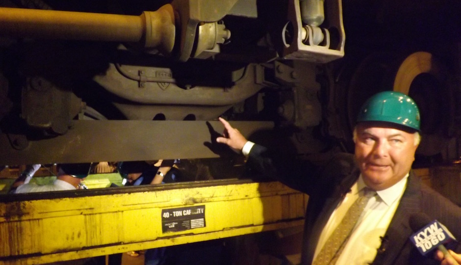 SEPTA Assistant GM for Operations Ron Hopkins describes how the equalizer bar (gray bar at left center in photo) is mounted onto the truck of a Silverliner V. | Photos: Sandy Smith