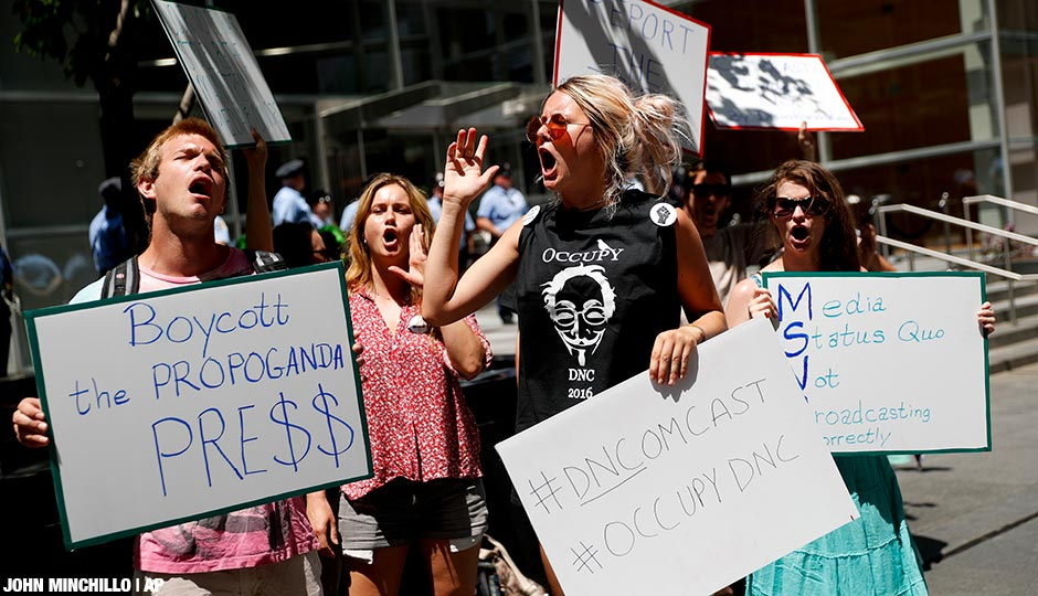 Demonstrators protest outside the Comcast Center in Philadelphia, Wednesday, July 27, 2016, during the third day of the Democratic National Convention.