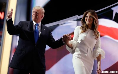 Republican presidential candidate Donald Trump gives his thumb up as he walks off the stage with his wife Melania during the Republican National Convention, Monday, July 18, 2016, in Cleveland.