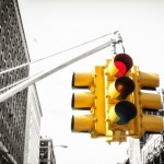 Yellow New York traffic light on red, with black and white background - colour pop